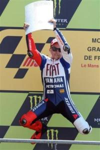 2230479786-spanish-motogp-driver-jorge-lorenzo-jubilates-on-the-podium-after